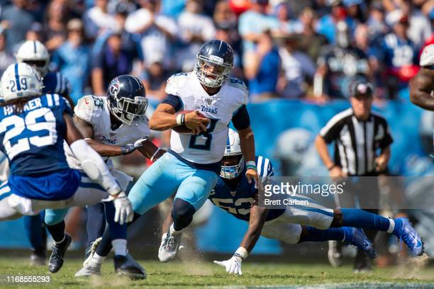 Marcus Mariota of the Tennessee Titans runs the ball for a first down in the final minutes of the game against the Indianapolis Colts at Nissan...