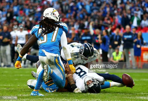 Marcus Mariota of the Tennessee Titans scores a touchdown which was reviewed and disallowed during the NFL International Series game between...