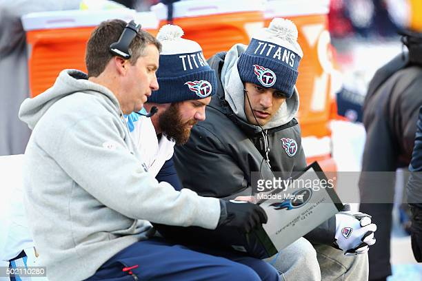 Marcus Mariota of the Tennessee Titans sits on the sideline during the game between the New England Patriots and the Tennessee Titans at Gillette...