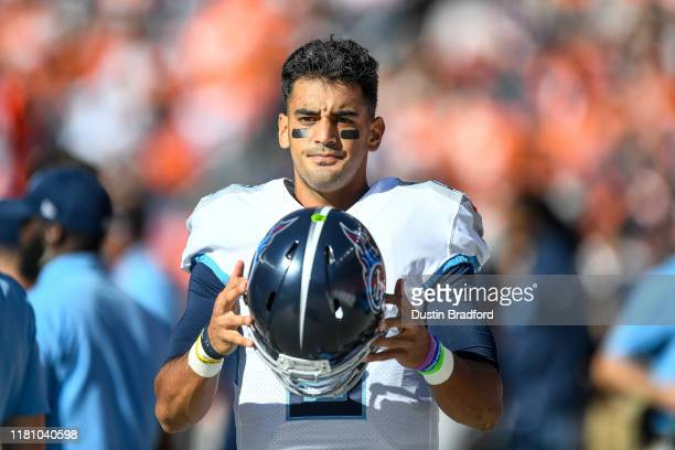 Marcus Mariota of the Tennessee Titans stands in the bench area during a game against the Denver Broncos at Empower Field at Mile High on October 13...