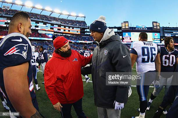 Marcus Mariota of the Tennessee Titans talks with Patriots Defensive Coordinator Matt Patricia at Gillette Stadium on December 20 2015 in Foxboro...