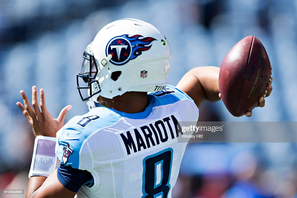 Marcus Mariota #8 of the Tennessee Titans throws a pass while warming up before a game against the Oakland Raiders at Nissan Stadium on September 25, 2016 in Nashville, Tennessee.