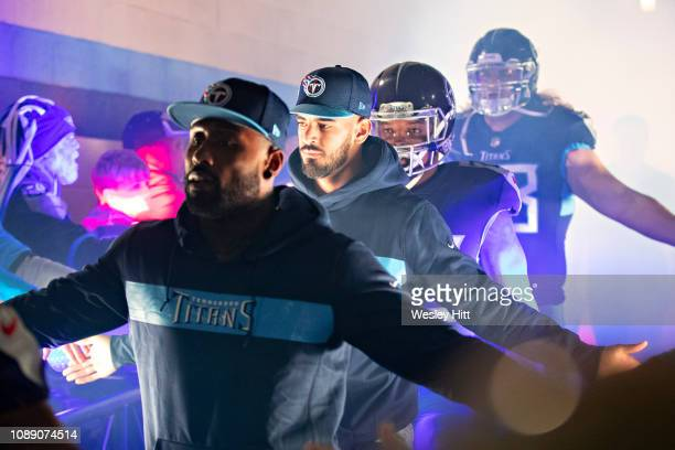 Marcus Mariota of the Tennessee Titans walks through a tunnel of fans before a game against the Indianapolis Colts at Nissan Stadium on December 30...
