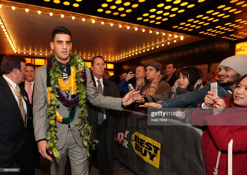 Marcus Mariota, quarterback for the University of Oregon Ducks, shakes hands with fans after being named the 80th Heisman Memorial Trophy Award winner after the 2014 Heisman Trophy Presentation at the Best Buy Theater on December 13, 2014 in New York City.