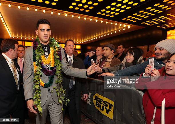 Marcus Mariota quarterback for the University of Oregon Ducks shakes hands with fans after being named the 80th Heisman Memorial Trophy Award winner...
