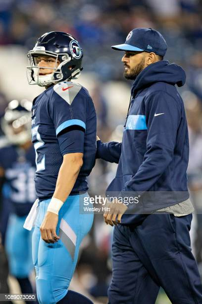 Marcus Mariota talks with Austin Davis of the Tennessee Titans on the field before a game against the Indianapolis Colts at Nissan Stadium on...