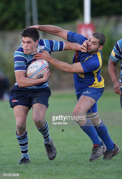 Marcus Marsh of the Leopards fends off Troy Becroft of the Hornets during the Fox Memorial Championship match between the Otahuhu Leopards and Howick...