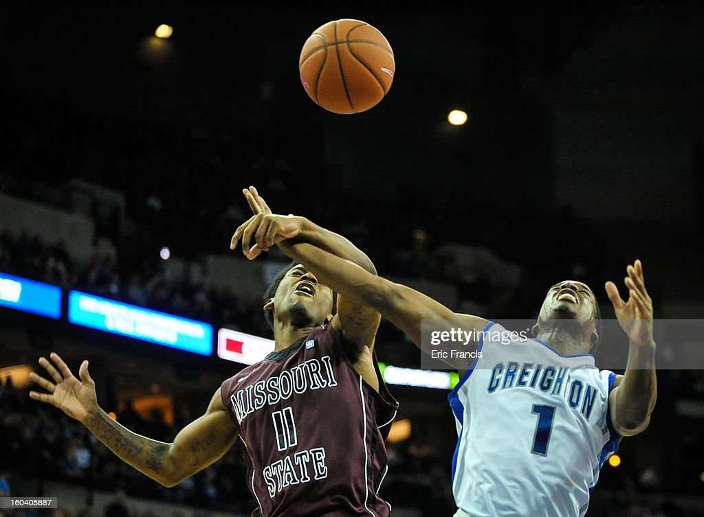 Marcus Marshall #11 of the Missouri State Bears fights with Austin Chatman #1 for a rebound of the Creighton Bluejays during their game at the CenturyLink Center on January 30, 2013 in Omaha, Nebraska. Creighton defeated Missouri State 91-77.