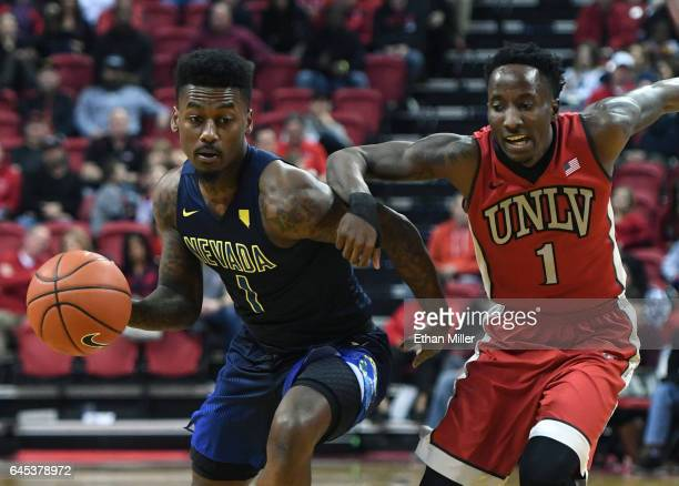 Marcus Marshall of the Nevada Wolf Pack drives against Kris Clyburn of the UNLV Rebels during their game at the Thomas Mack Center on February 25...