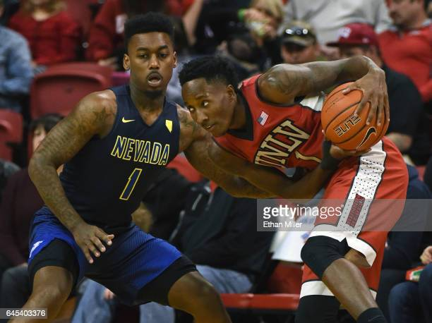 Marcus Marshall of the Nevada Wolf Pack guards Kris Clyburn of the UNLV Rebels during their game at the Thomas Mack Center on February 25 2017 in Las...