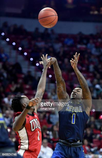 Marcus Marshall of the Nevada Wolf Pack shoots a 3pointer against Kris Clyburn of the UNLV Rebels during their game at the Thomas Mack Center on...