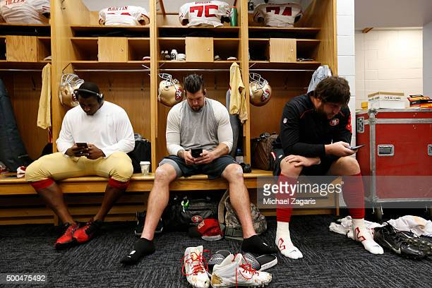 Marcus Martin Alex Boone amd Joe Staley of the San Francisco 49ers relax in the locker room prior to the game against the Chicago Bears at Soldier...