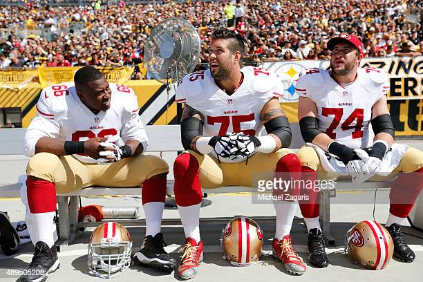 Marcus Martin Alex Boone and Joe Staley of the San Francisco 49ers sit on the bench during the game against the Pittsburgh Steelers at Heinz Field on...
