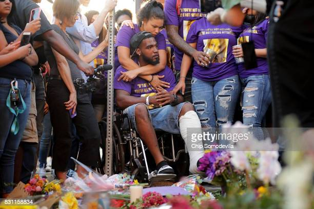 Marcus Martin who was injured when a car plowed into a crowd of people protesting against the white supremacist Unite the Right rally and his wife...