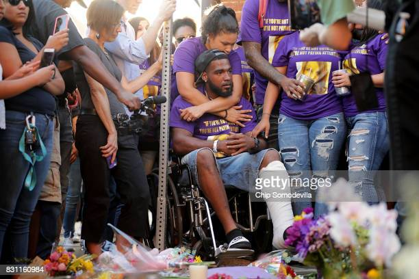 Marcus Martin who was injured when a car plowed into a crowd of people protesting against the white supremacist Unite the Right rally his wife...