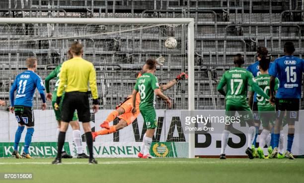 Marcus Mathisen of Halmstad BK scores 12 to of Halmstad BK during the Allsvenskan match between Hammarby IF and Halmstad BK at Tele2 Arena on...