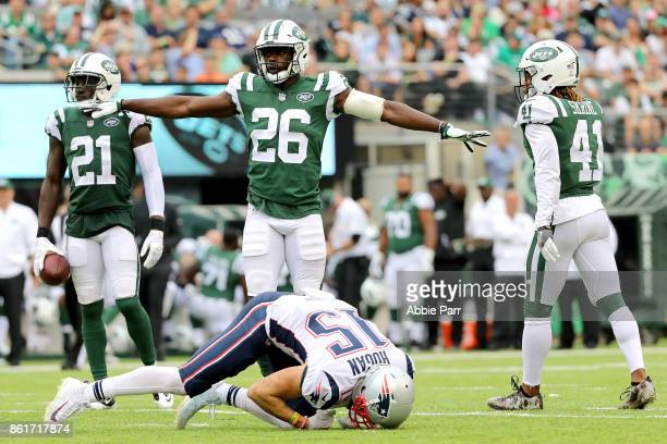 Marcus Maye of the New York Jets reacts in the first half after making a defensive stop against Chris Hogan of the New England Patriots during their...