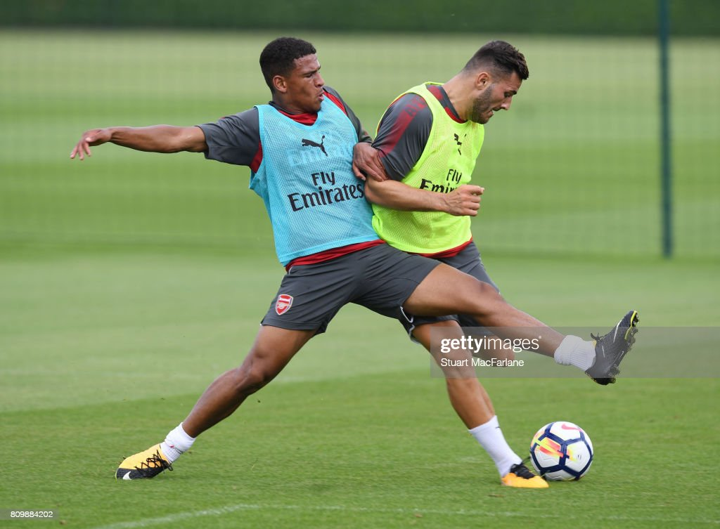 Marcus McGuane and Sead Kolasinac of Arsenal during a training session at London Colney on July 6, 2017 in St Albans, England.