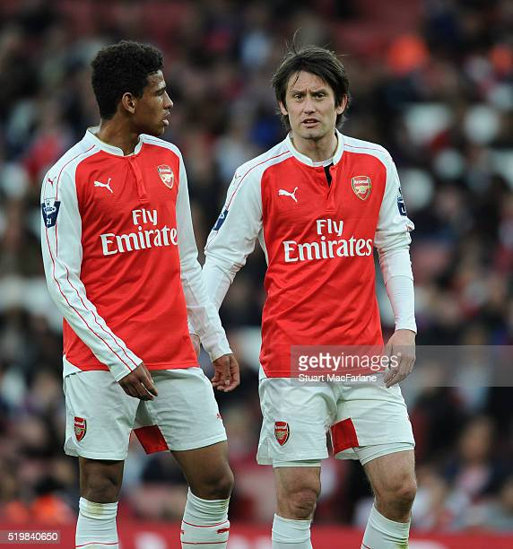 Marcus McGuane and Tomas Rosicky of Arsenal during the Barclays Premier League match between Arsenal and Newcastle United at Emirates Stadium on...