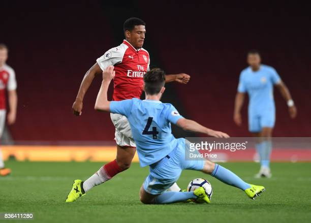 Marcus McGuane of Arsenal takes on Edward Francis of Man City during the match between Arsenal U23 and Manchester City U23 at Emirates Stadium on...
