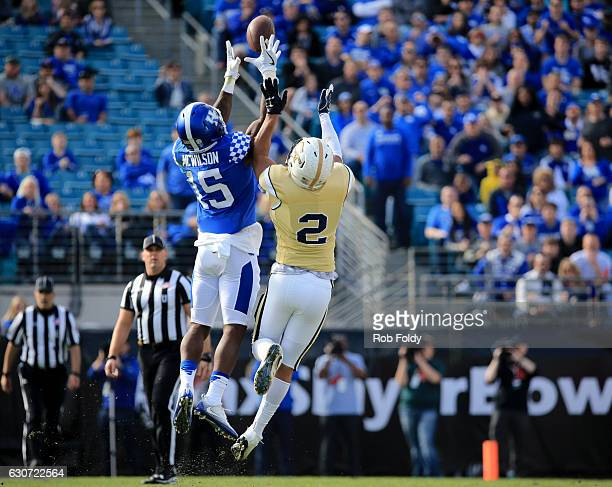 Marcus McWilson of the Kentucky Wildcats attempts to intercept a pass intended for Ricky Jeune of the Georgia Tech Yellow Jackets during the first...