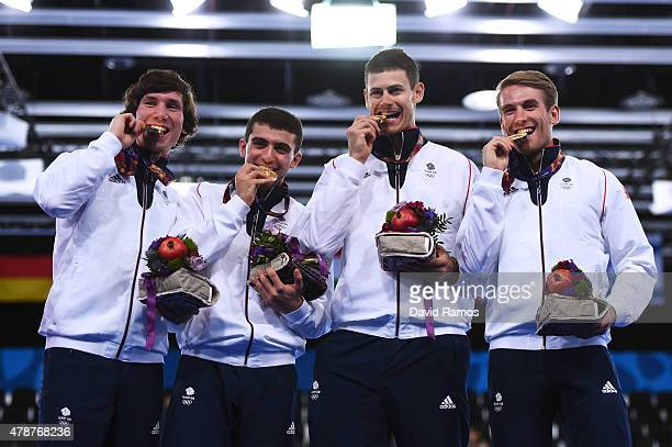 Marcus Mepstead Alex Tofalides Richard Kruse and Benjamin Peggs of Great Britain pose on the medal podium following their victory over Italy in the...