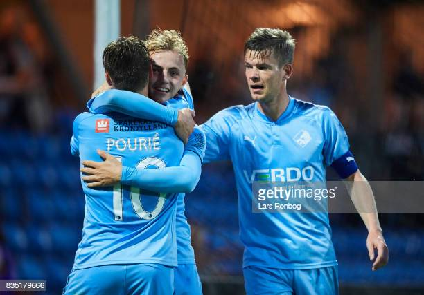 Marcus Molvadgaard Marvin Pourie and Mads Agesen of Randers FC celebrates after scoring their first goal during the Danish Alka Superliga match...