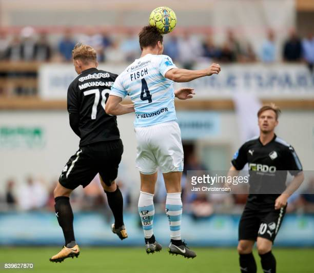 Marcus Molvadgaard of Randers FC and Martin Fisch of FC Helsingor heading the ball during the Danish Alka Superliga match between FC Helsingor and...