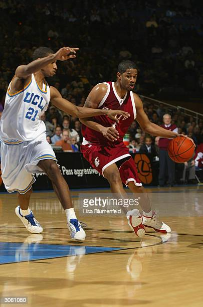 Marcus Moore of the Washington State Cougars is defended by Cedric Bozeman of the UCLA Bruins during the game at Pauley Pavillion on February 5 2004...