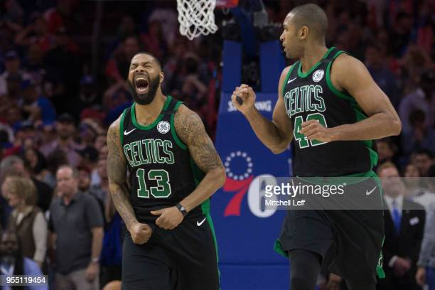 Marcus Morris and Al Horford of the Boston Celtics react in the final second of the fourth quarter against the Philadelphia 76ers during Game Three...