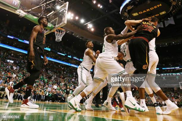 Marcus Morris and Terry Rozier of the Boston Celtics get into an altercation with Larry Nance Jr #22 of the Cleveland Cavaliers in the first half...