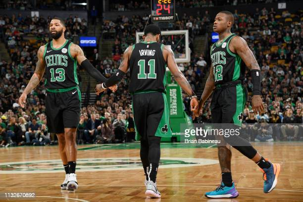 Marcus Morris Kyrie Irving and Terry Rozier of the Boston Celtics high five against the San Antonio Spurs on March 24 2019 at the TD Garden in Boston...