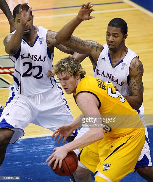 Marcus Morris left and his twin brother Markieff guard Valparaiso's Kevin Van Wijk during the second half of the Jayhawks' 7944 win over the...