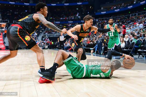 Marcus Morris looks to pass to Kyrie Irving of the Boston Celtics against John Collins and Trae Young of the Atlanta Hawks on January 19 2019 at...