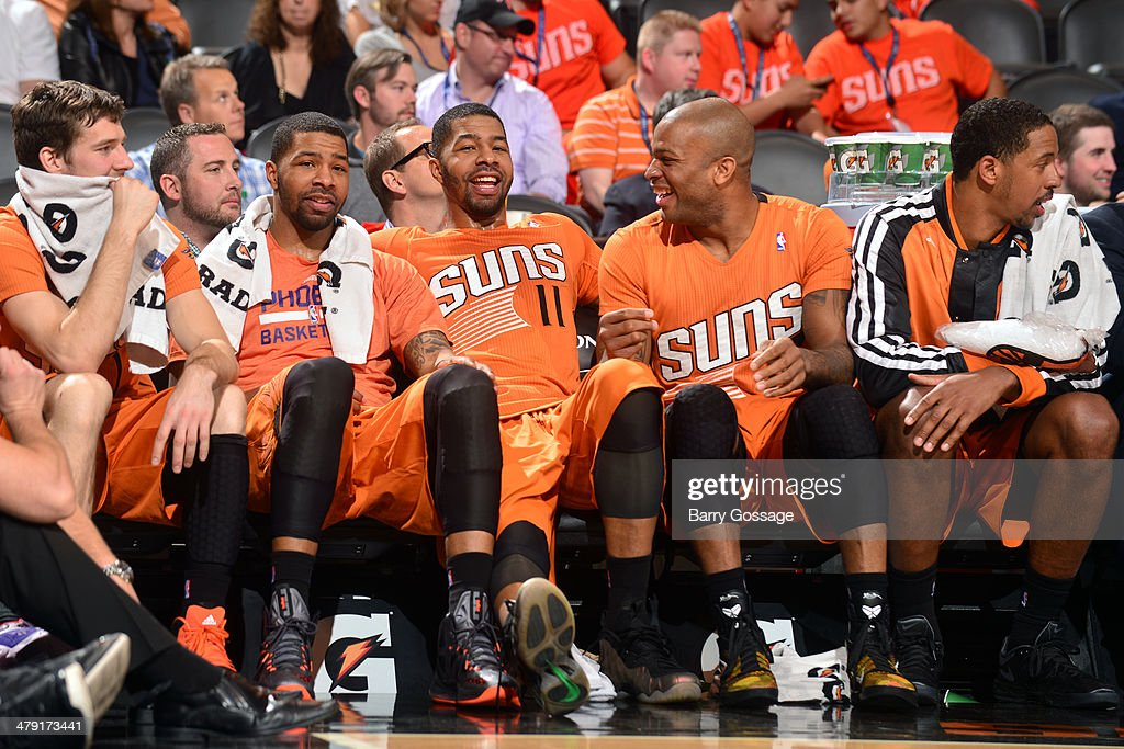 Marcus Morris #15, Markieff Morris #11, Goran Dragic #1, P.J. Tucker #17 and Channing Frye #8 of the Phoenix Suns on the bench during a game against the San Antonio Spurs on February 21, 2014 at U.S. Airways Center in Phoenix, Arizona.