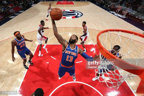 Marcus Morris of New York Knicks grabs the rebound against the Washington Wizards during the preseason on October 7 2019 at Capital One Arena in...