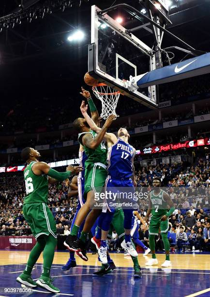 Marcus Morris of the Boston Celtics and JJ Redick of the Philadelphia 76ers battle for the ball during the NBA game between Boston Celtics and...