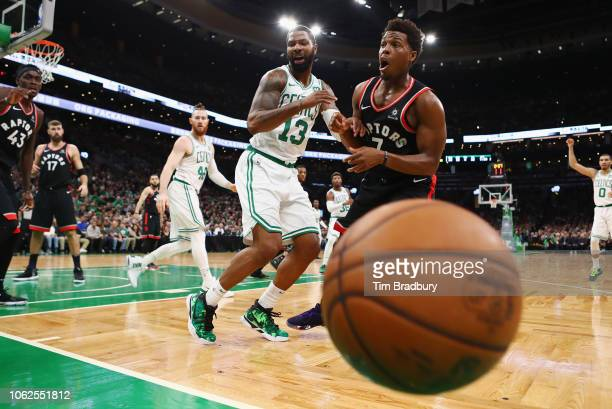 Marcus Morris of the Boston Celtics and Kyle Lowry of the Toronto Raptors react after battling for the ball during the second half at TD Garden on...