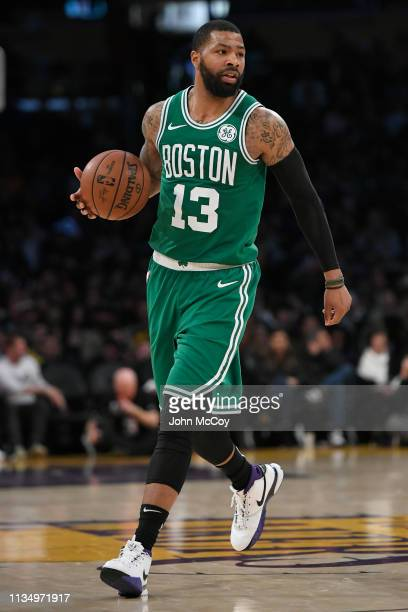 Marcus Morris of the Boston Celtics brings the ball up the floor against the Los Angeles Lakers at Staples Center on March 9 2019 in Los Angeles...