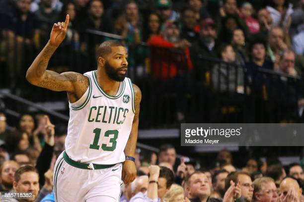 Marcus Morris of the Boston Celtics celebrates after hitting a three point shot during the first quarter against the Milwaukee Bucks at TD Garden on...