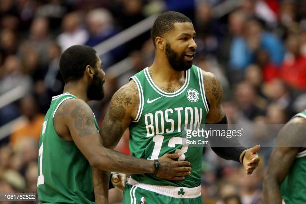 Marcus Morris of the Boston Celtics celebrates with Kyrie Irving after hitting a shot in the second half against the Washington Wizards at Capital...
