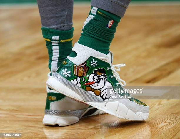 Marcus Morris of the Boston Celtics Christmas themed sneakers before the game against the Philadelphia 76ers at TD Garden on December 25 2018 in...