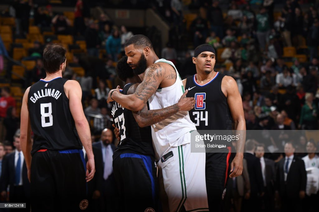 Marcus Morris #13 of the Boston Celtics congratulates Lou Williams #23 of the LA Clippers after the game on February 14, 2018 at the TD Garden in Boston, Massachusetts.