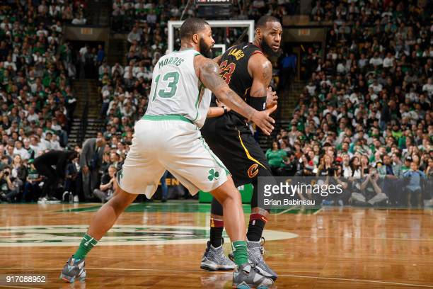 Marcus Morris of the Boston Celtics defends against LeBron James of the Cleveland Cavaliers during the game between the two teams on February 11 2018...