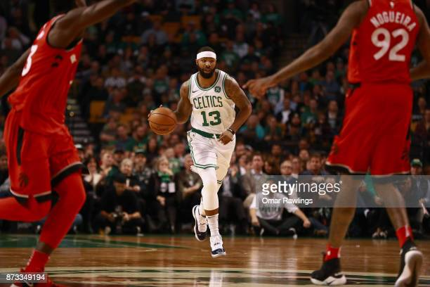 Marcus Morris of the Boston Celtics dribbles up the court during the first quarter of the game against the Toronto Raptors at TD Garden on November...