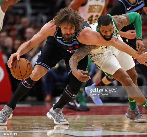 Marcus Morris of the Boston Celtics fouls Robin Lopez of the Chicago Bulls as they battle for the ball at the United Center on February 23 2019 in...