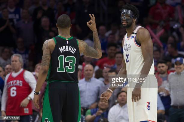 Marcus Morris of the Boston Celtics gestures to Joel Embiid of the Philadelphia 76ers in the third quarter during Game Four of the Eastern Conference...