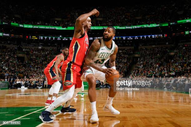 Marcus Morris of the Boston Celtics handles the ball against Dante Cunningham of the New Orleans Pelicans on January 16 2018 at the TD Garden in...