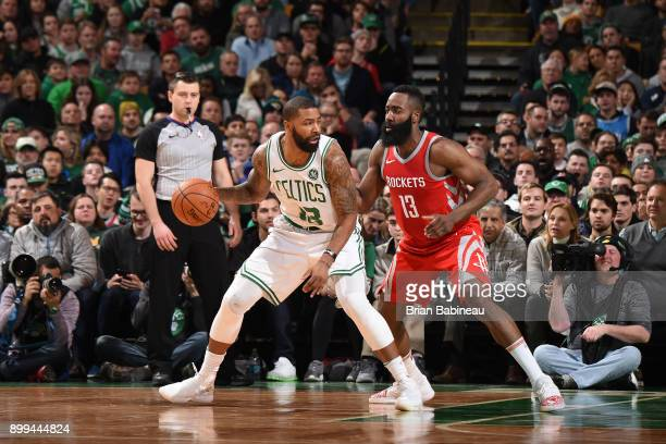 Marcus Morris of the Boston Celtics handles the ball against James Harden of the Houston Rockets on December 28 2017 at the TD Garden in Boston...