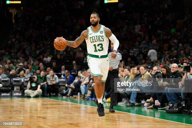 Marcus Morris of the Boston Celtics handles the ball against the Charlotte Hornets during a preseason game on September 30 2018 at the TD Garden in...